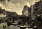 Zdjęcie z początku XXw. przedstawiające Most Kotlarski oraz stan resztek murów obronnych, na których postawiono budynki. Między budynkami naprzeciw mostu do roku 1843 stała Brama Kotlarska